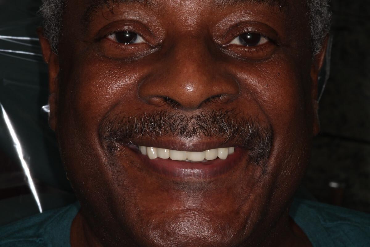 close up of smiling older man