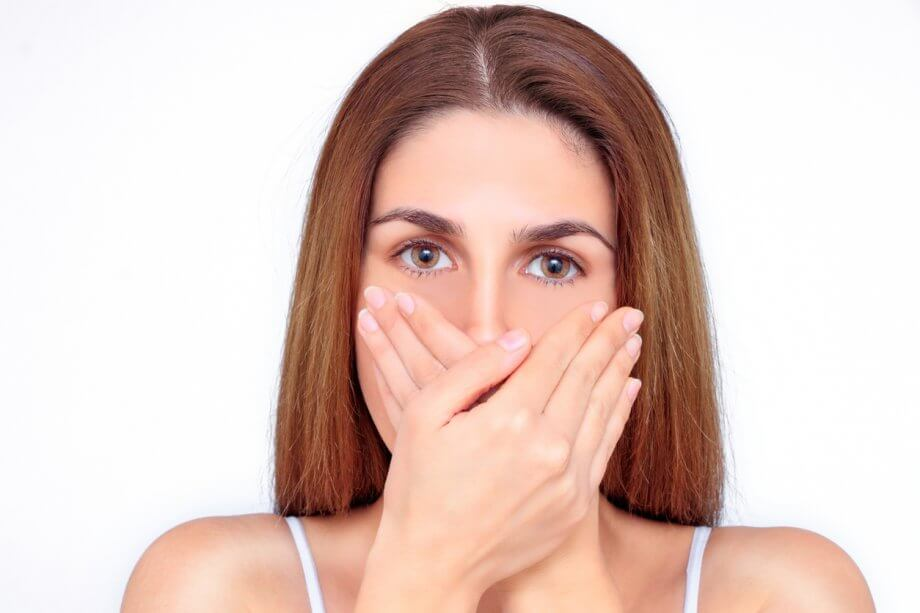 Woman Covering Mouth Due To Bad Breath