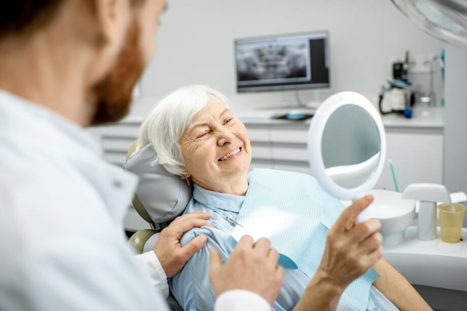 elderly woman at dentist office